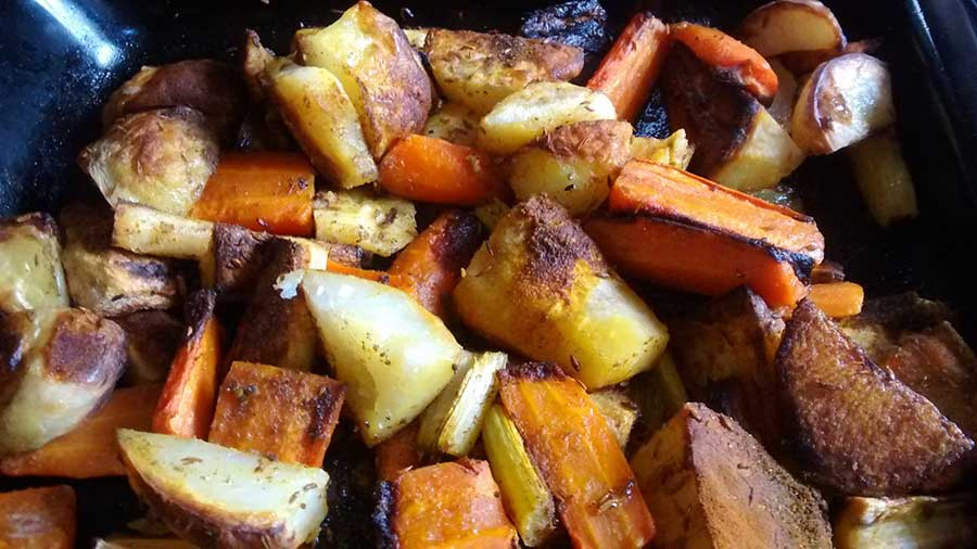 A dish of golden curried roast vegetables.