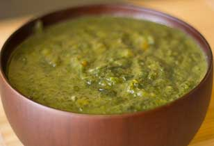 Bowl of vibrant green spinach soup.