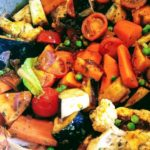 A pan of colourful vegetables and brinjal pickle.